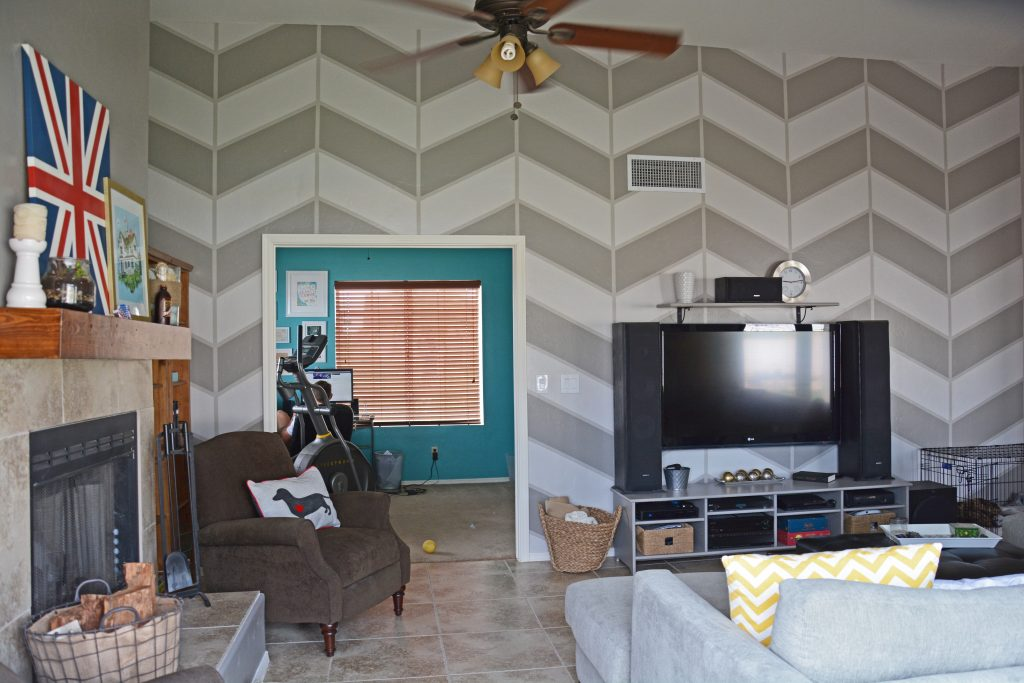 living-room-with-large-scale-herringbone-pattern-painted-on-wall-in-gray-colors