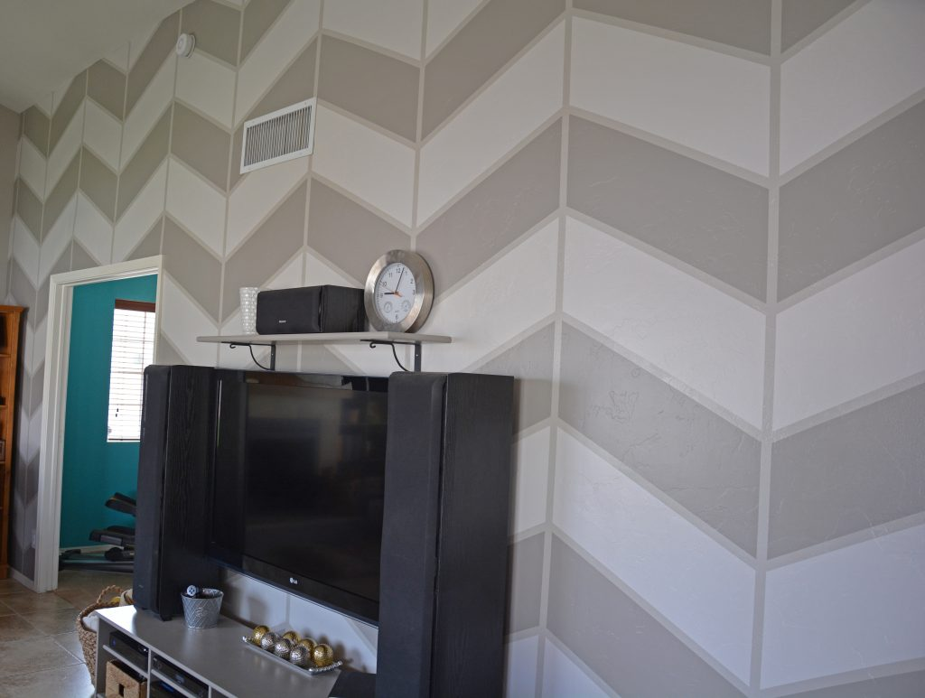 sideways-look-at-large-scale-herringbone-pattern-painted-on-wall-in-gray-colors