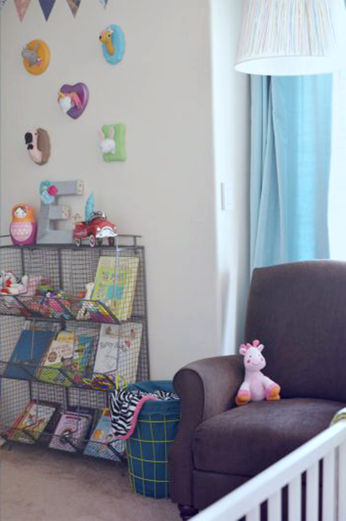 brown-recliner-and-metal-bookcase-in-nursery