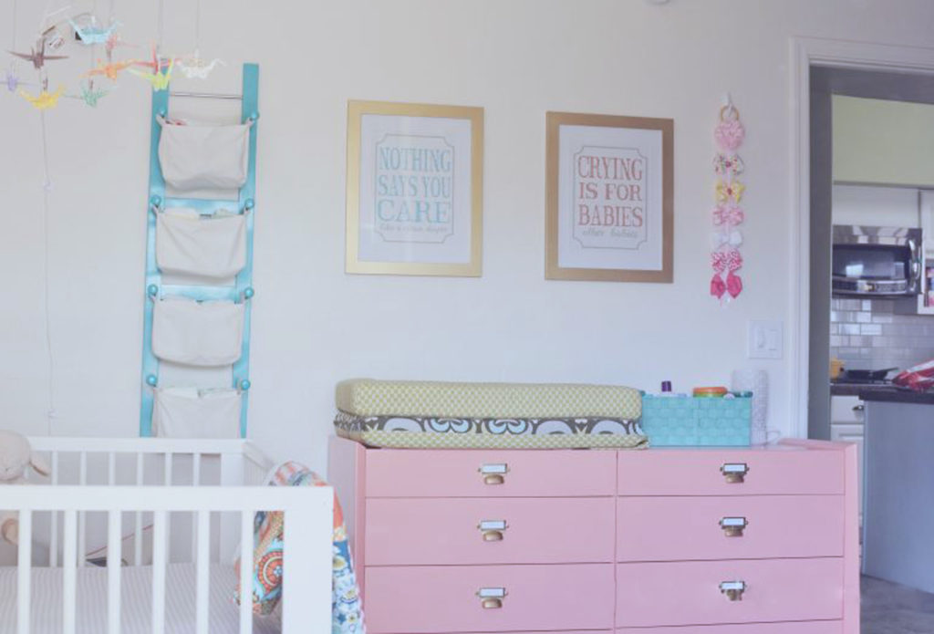 coral-painted-dresser-as-changing-table
