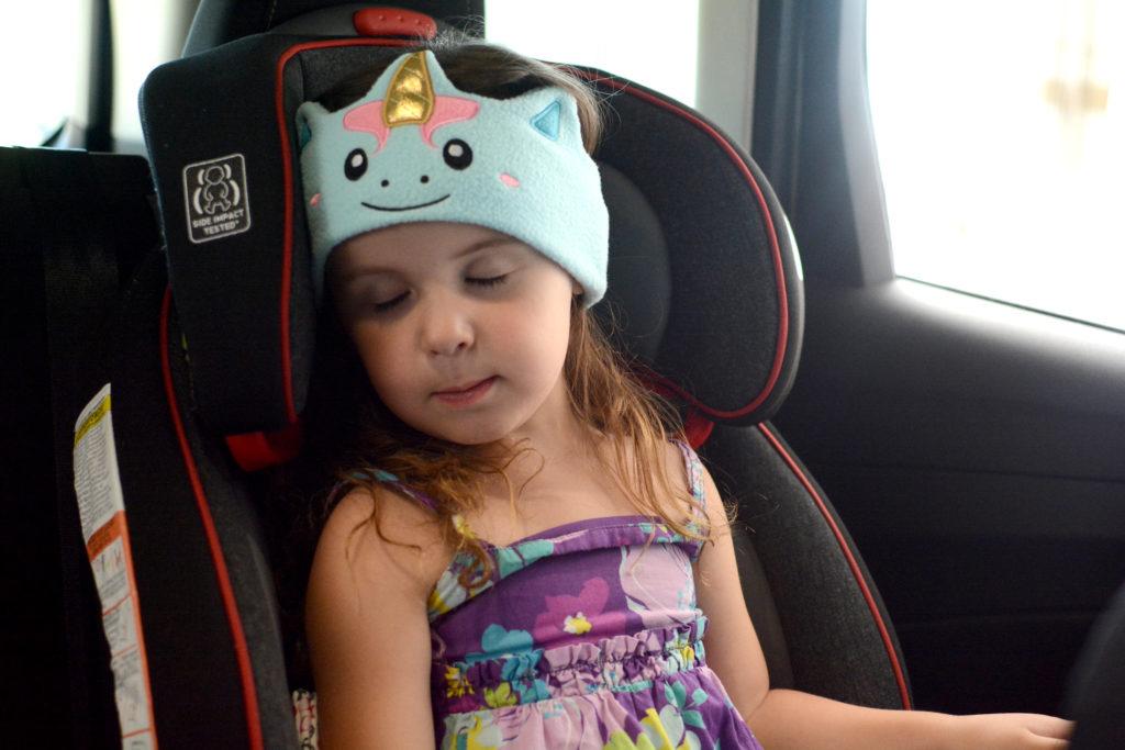 Toddler asleep in carseat wearing cozyphones headphones