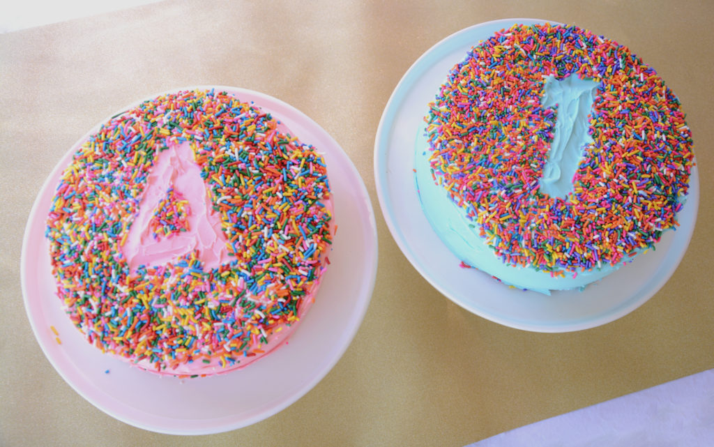pink cake with sprinkles and blue cake with sprinkles
