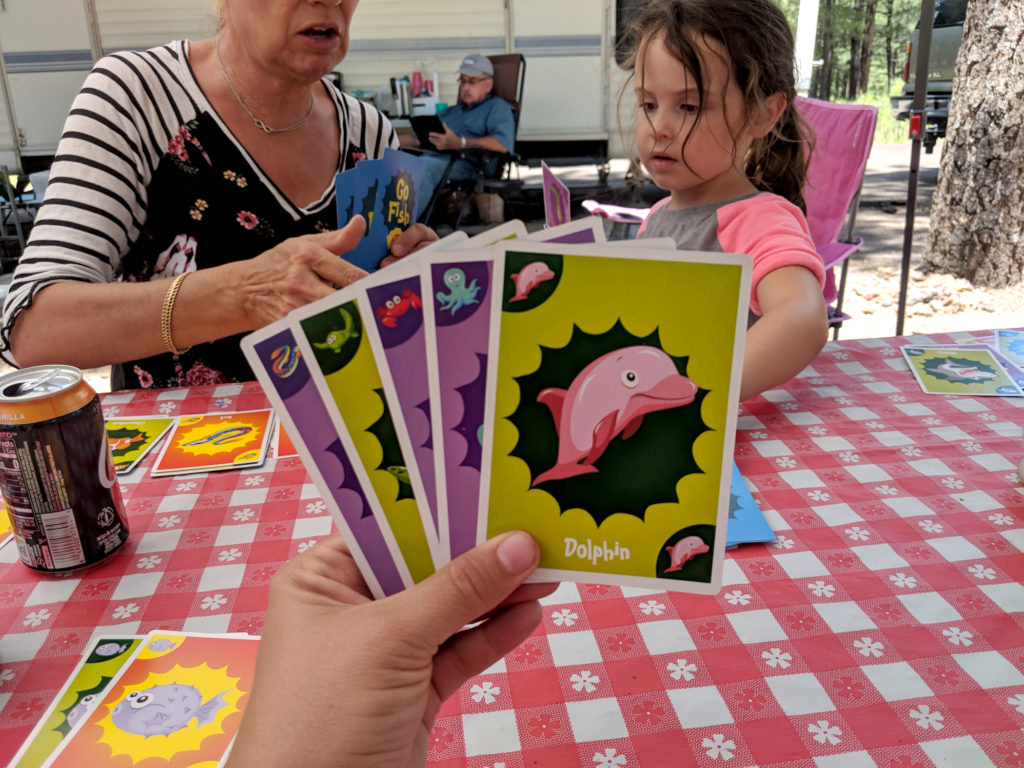 A hand, holding a hand of Go Fish cards