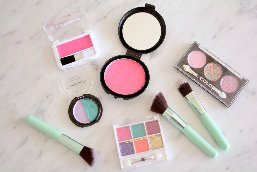 Flatlay of DIY pretend makeup and various makeup brushes