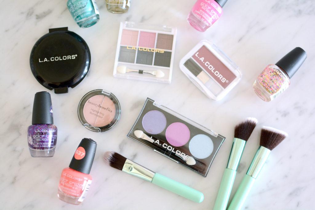 Flatlay of various makeup, nail polishes, and makeup brushes